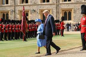 WINDSOR, ENGLAND - JULY 13:  Queen Elizabeth II and President of the United States, Donald Trump inspect an honour guard at Windsor Castle on July 13, 2018 in Windsor, England.  Her Majesty welcomed the President and Mrs Trump at the dais in the Quadrangle of the Castle. A Guard of Honour, formed of the Coldstream Guards, gave a Royal Salute and the US National Anthem was played. The Queen and the President inspected the Guard of Honour before watching the military march past. The President and First Lady then joined Her Majesty for tea at the Castle.  (Photo by Chris Jackson/Getty Images)