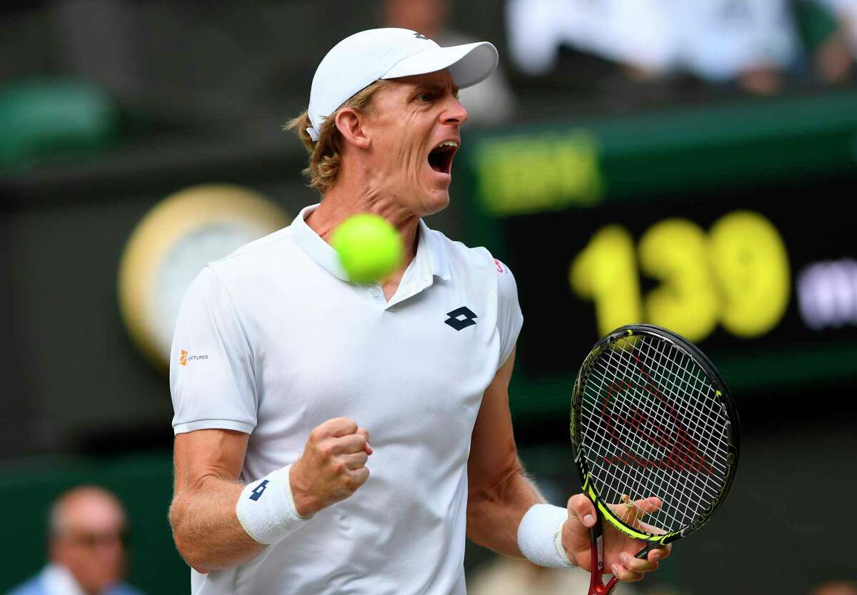 Kevin Anderson of South Africa celebrates winning a point from John Isner of the US during their men's singles semifinal match at the Wimbledon Tennis Championships, in London, Friday July 13, 2018. (AP Photo/Glyn Kirk, Pool)