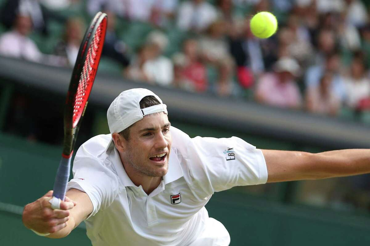 TOPSHOT - US player John Isner returns against South Africa's Kevin Anderson during their men's singles semi-final match on the eleventh day of the 2018 Wimbledon Championships at The All England Lawn Tennis Club in Wimbledon, southwest London, on July 13, 2018. / AFP PHOTO / Daniel LEAL-OLIVAS / RESTRICTED TO EDITORIAL USEDANIEL LEAL-OLIVAS/AFP/Getty Images