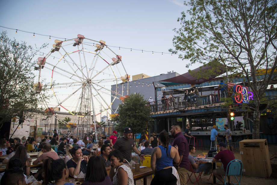 The Ferris wheel adds a touch of whimsy to the outdoor setting of Truck Yard in EaDo. Photo: Marie D. De Jesus/Houston Chronicle