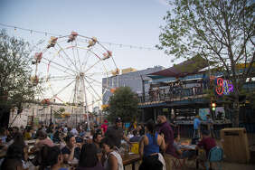 The Ferris wheel adds a touch of whimsy to the outdoor setting of Truck Yard in EaDo.