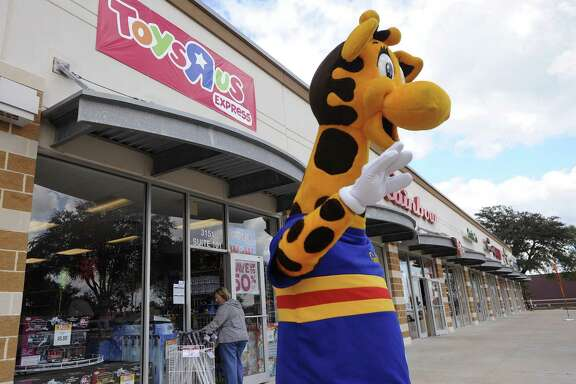 The San Antonio Zoo wants Toys R Us to donate its mascot, Geoffrey, so the zoo can use him as a symbol for giraffe conservation. In this 2010 photo, Geoffrey greets customers at a Toys R Us Express on Southeast Military at I-37.