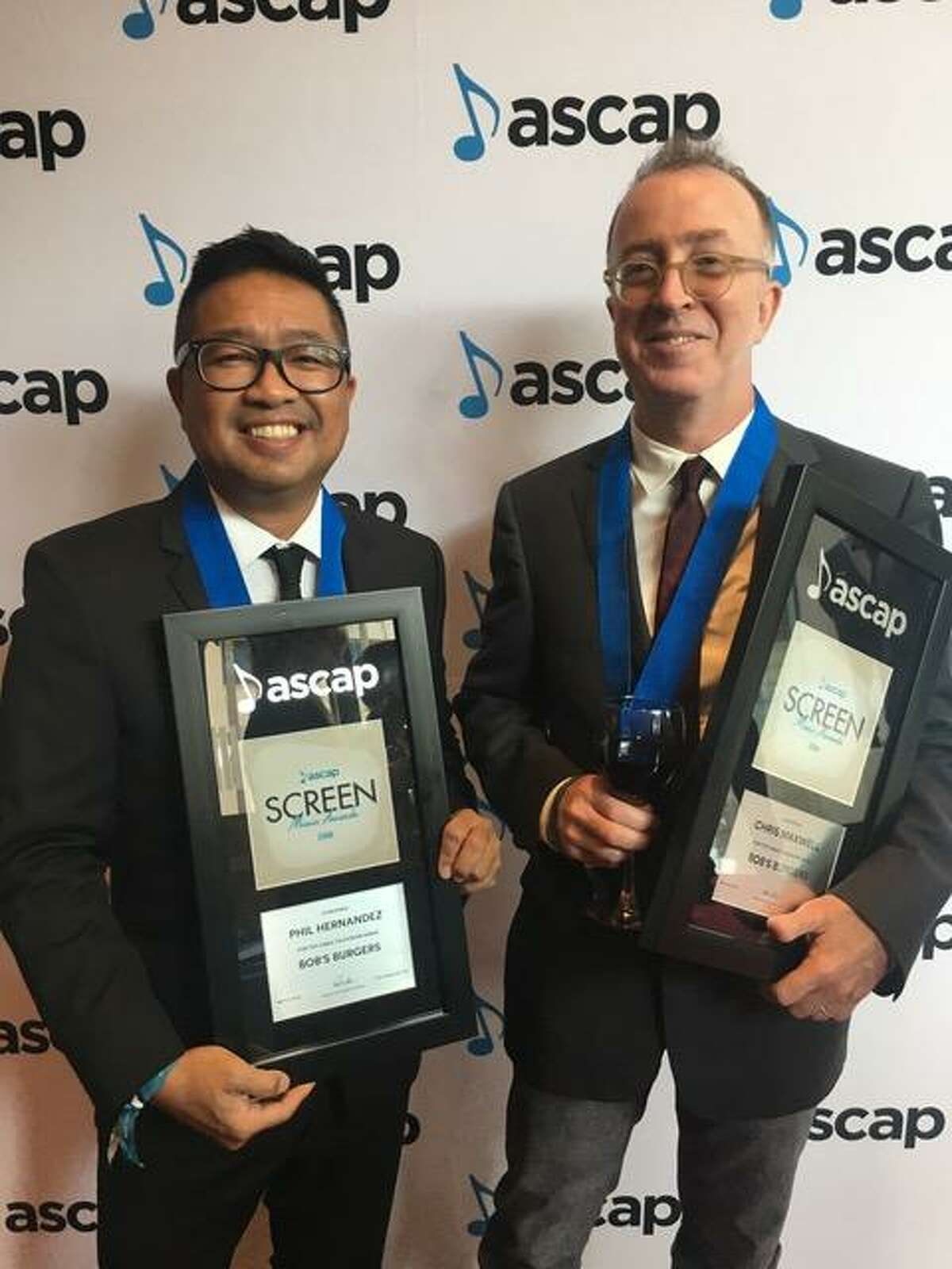 """Phil Hernandez (on left) and Chris Maxwell with their 2018 ASCAP Awards for the Fox animated series ?""""Bob?'s Burgers.?"""""""