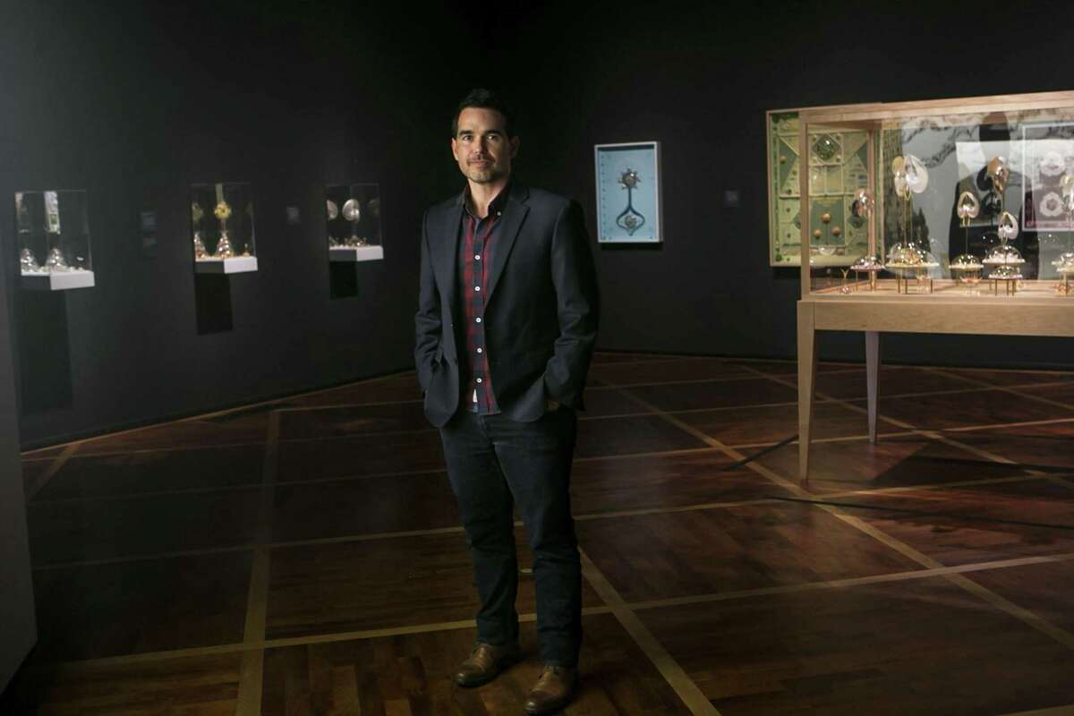 """Dario Robleto poses in his show """"Ancient Beacons Long for Notice"""" at the McNay June 28, 2018. This is the McNay's first major presentation of works by Robleto, a San Antonio native who lives in Houston but increasingly works around the U.S. with scientists, engineers and academics in a variety of fields."""