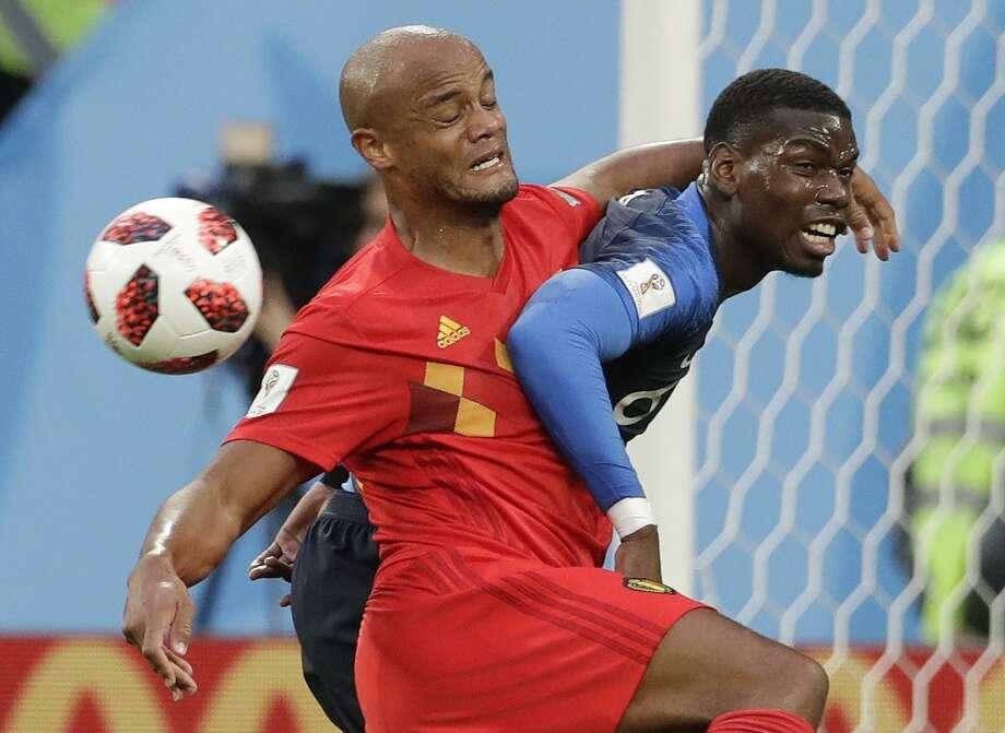 Belgium's Vincent Kompany, left, and France's Paul Pogba vie for the ball during the semifinal match between France and Belgium at the 2018 soccer World Cup in the St. Petersburg Stadium, in St. Petersburg, Russia, Tuesday, July 10, 2018. Kompany and Pogba, respectively, play at the club level for Manchester City and Manchester United in the English Premier League, whose 2018-19 season kicks off Aug. 10, 2018. Photo: Petr David Josek / Associated Press / Copyright 2018 The Associated Press. All rights reserved
