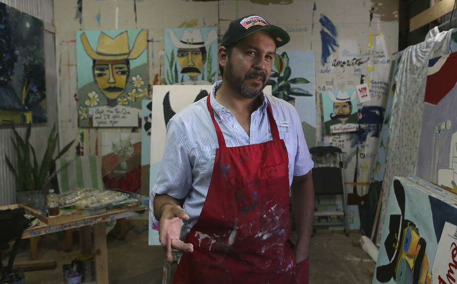 San Antonio artist Cruz Ortiz, shown in his studio in 2016, intends to continue designing special pizza boxes for the local franchise of the Papa John's pizza chain. Photo: John Davenport /San Antonio Express-News / ©San Antonio Express-News/John Davenport