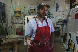 San Antonio artist Cruz Ortiz, shown in his studio in 2016, intends to continue designing special pizza boxes for the local franchise of the Papa John's pizza chain.