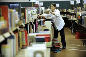 File photo volunteers setting up for Mark Twain Library's annual book fair.