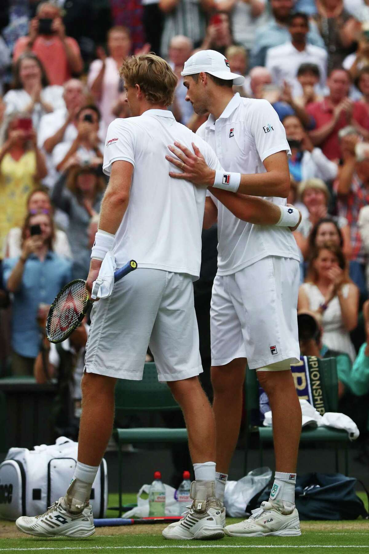 LONDON, ENGLAND - JULY 13: Kevin Anderson of South Africa (L) hugs John Isner of The United States after their Men's Singles semi-final match on day eleven of the Wimbledon Lawn Tennis Championships at All England Lawn Tennis and Croquet Club on July 13, 2018 in London, England.
