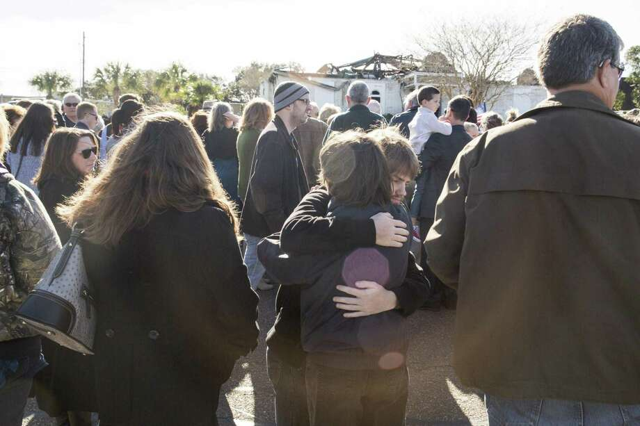 Andy Polasek hugs Mary Spaulding outside the Islamic Center of Victoria before a prayer session to show support for the Muslim community Jan. 29, 2017, after the mosque burned down in Victoria. The prosecution wrapped up its case Friday morning in the trial of Marq Vincent Perez, charged with burning down the local mosque in 2017 as a hate crime. Photo: Staff File Photo / 2017 San Antonio Express-News