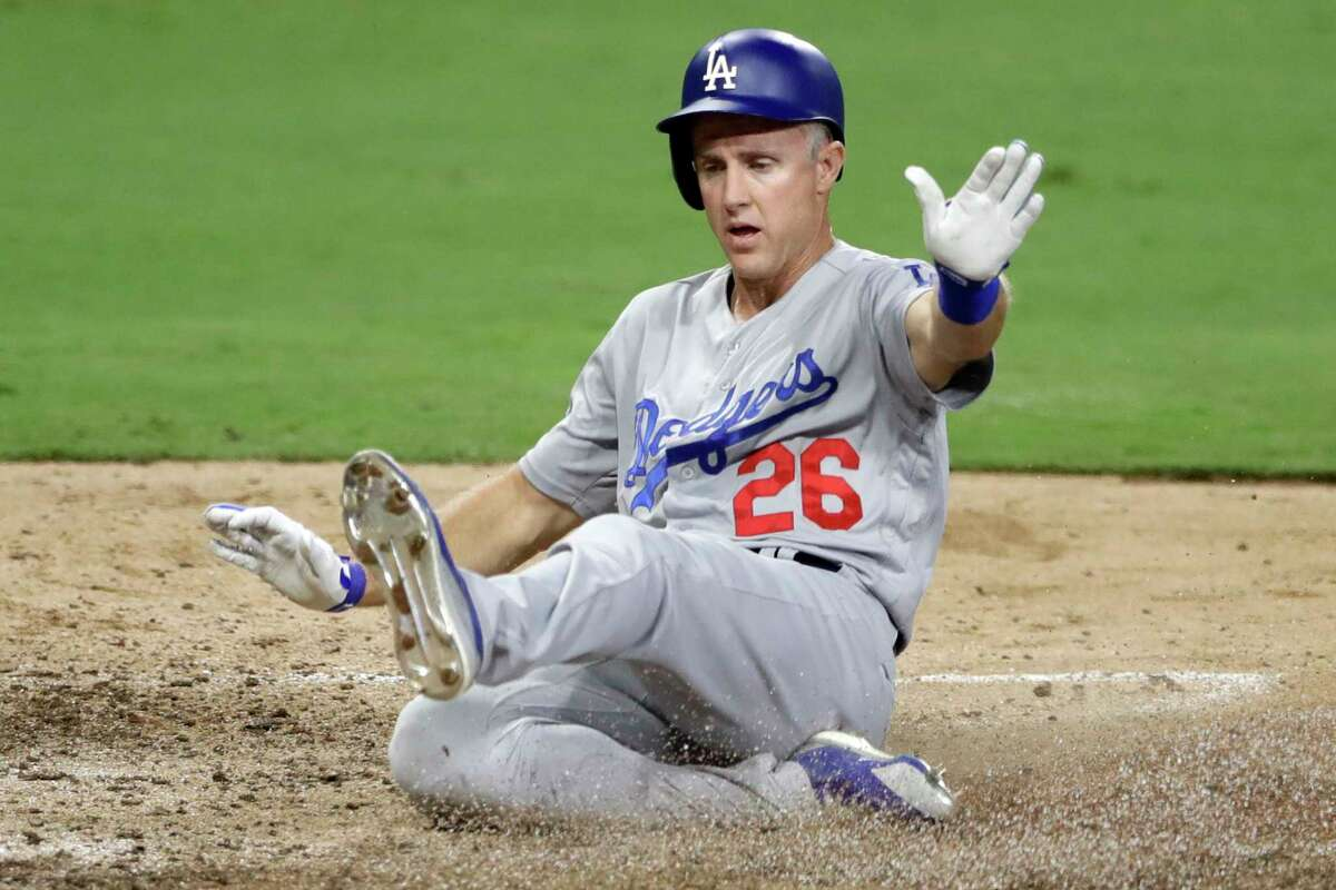 Los Angeles Dodgers' Chase Utley scores from second off a single by Justin Turner during the eighth inning of a baseball game against the San Diego Padres, Monday, July 9, 2018, in San Diego. (AP Photo/Gregory Bull)