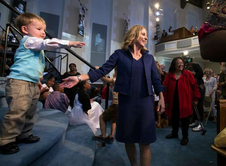 Karen Hanrahan, center, gathers up son Finn Wagner, 3, at a service where she was introduced as the new president and CEO of Glide Memorial Church, on Sunday, Aug. 27, 2017 in San Francisco, Calif. (D. Ross Cameron / Special to The Chronicle)