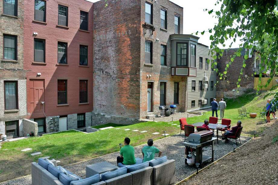Backyard of developer Patrick Chiou's redevelopment of 800-806 Broadway transforming four dilapidated buildings, abandoned for nearly a decade into 15 new one and two-bedroom apartments Friday July 13, 2018 in Albany, NY.  (John Carl D'Annibale/Times Union) Photo: John Carl D'Annibale, Albany Times Union / 20044346A