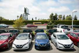 A row of new 2018 Nissan LEAF electric vehicles at the Jim Bone Nissan dealership in Santa Rosa, California, Thursday, May 3, 2018. Author Beth Osborne argues we need a better transportation grid, not more electric vehicles. Ramin Rahimian/Special to The Chronicle