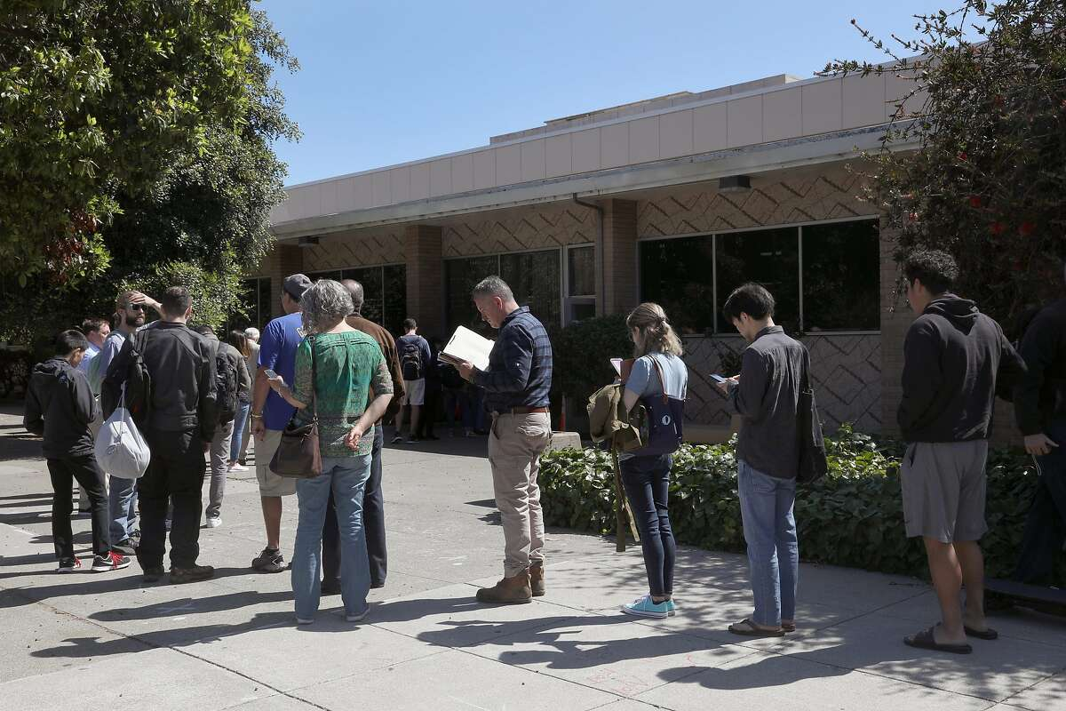 Line seen for already scheduled appointments at the State Department of Motor Vehicles on Thursday, July 5, 2018 in San Francisco, Calif. YoGov, an Oakland company that promises �expedited appointments� at field offices at a time when lines at the DMV are getting longer and appointments harder to schedule.