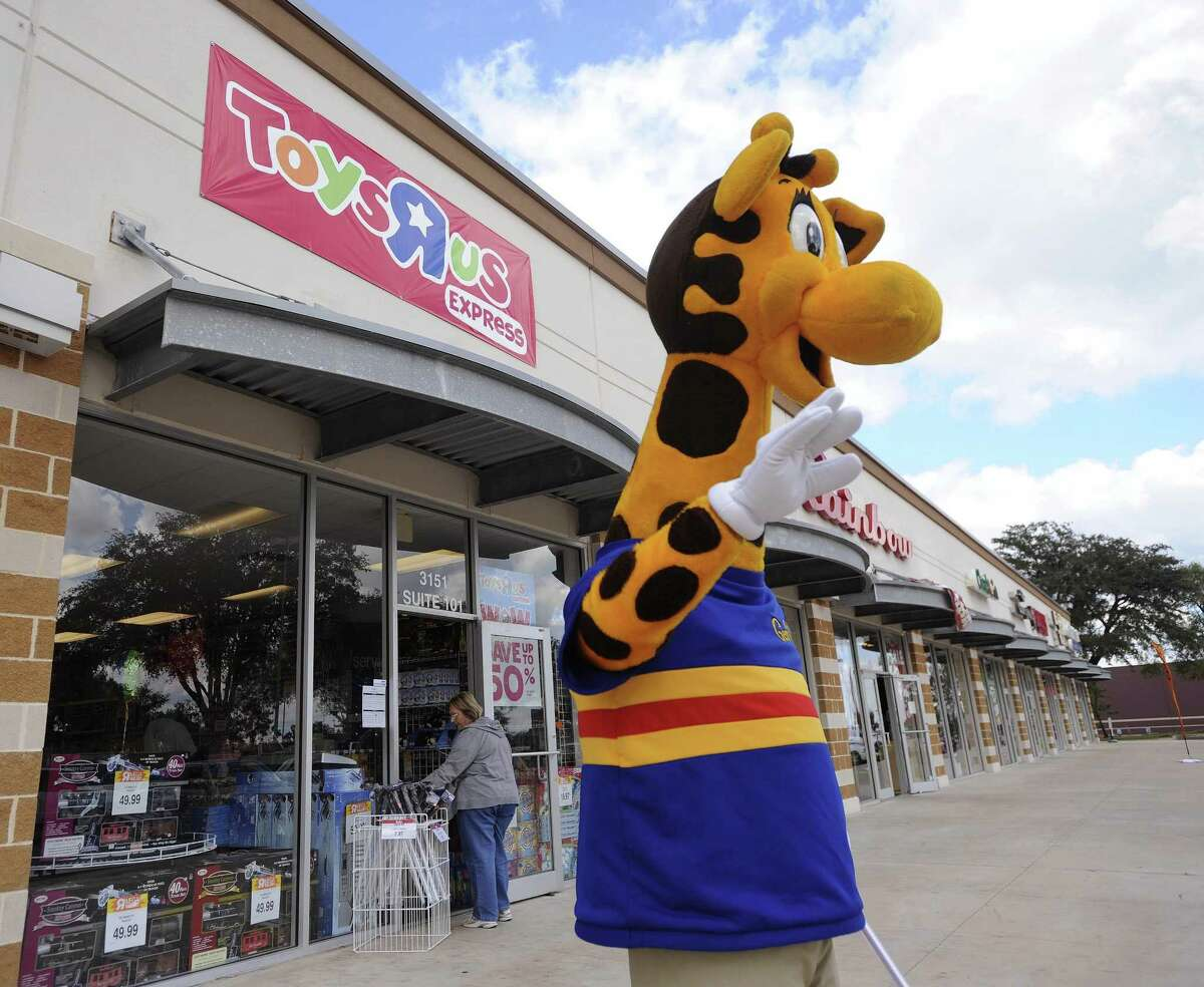 The San Antonio Zoo wants Toys R Us to donate its mascot, Geoffrey, so the zoo can use him as a symbol for giraffe conservation. In this 2010 photo, Geoffrey greets customers at Toys R Us Express on Southeast Military at I-37.