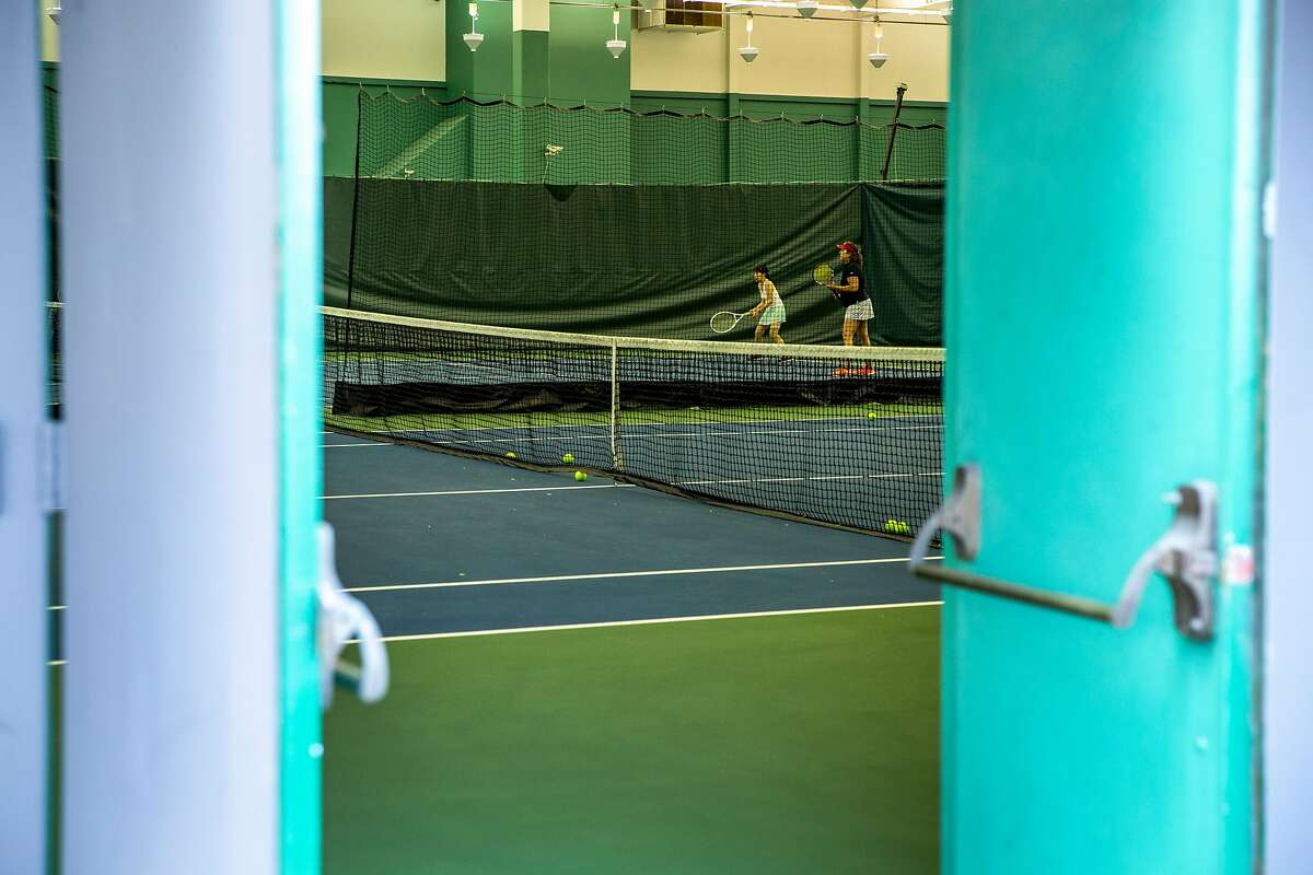 People inside the Bay Club SF Tennis located at 645 5th St., Thursday, July 12, 2018, in San Francisco, Calif.