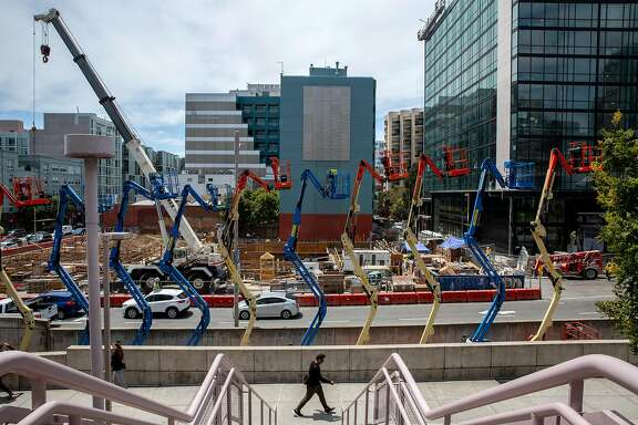 A man walks past the construction site at 4th Street and Folsom Street, Thursday, July 12, 2018, in San Francisco, Calif.