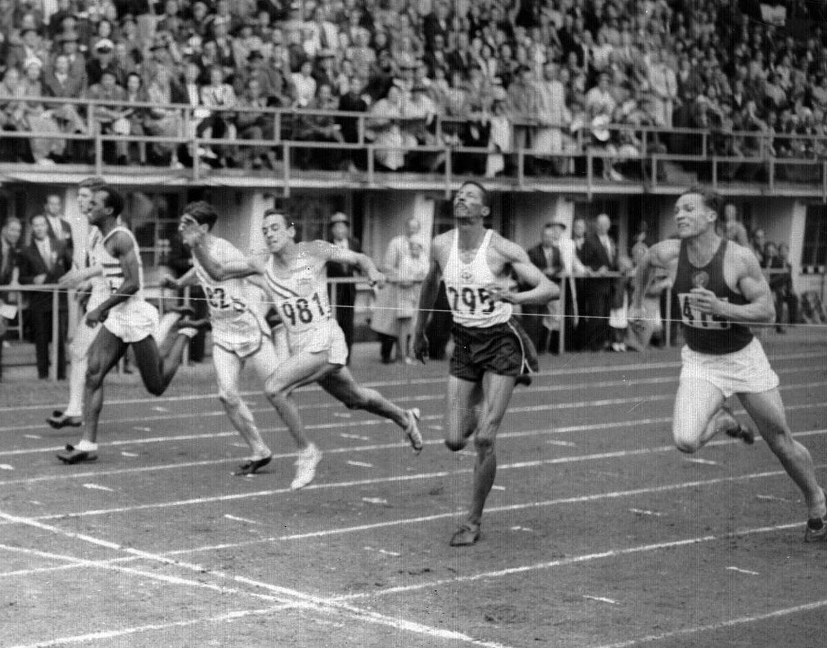 Lindy Remigino (981) wins the 100-meter final in Olympic games at Helsinki, Finland on July 21, 1952. Jamaica's Herb McKenley (295) was second. Remignio's time was 10.4 seconds.