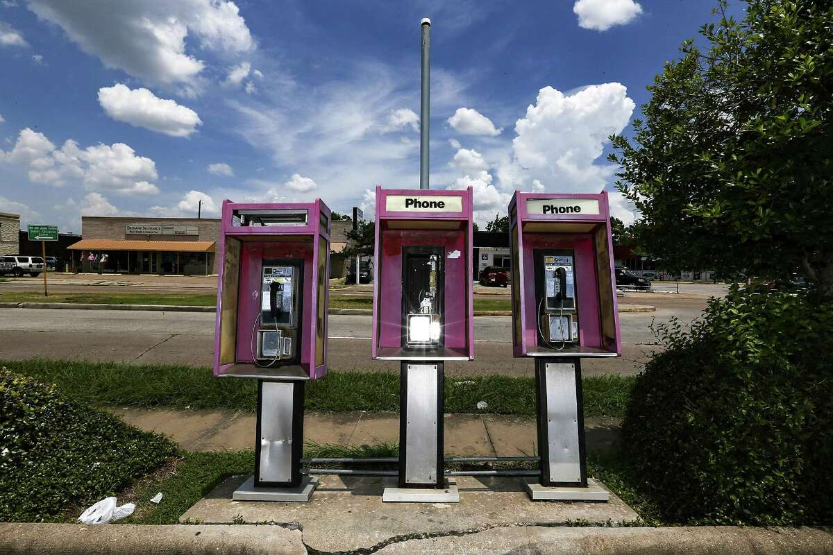 """Pay phones in front of a Gulf gas station on Hillcroft Street in southwest Houston photographed on July 13, 2018. These phones were surveilled with a pole camera after federal agents began investigating a fraud scheme involving automated calls to toll free numbers for state and federal agencies and private businesses. David Grudzinski, who owned 450 phones in the Houston area, admitted he collected the 49 cent reimbursements for each of roughly 4.8 million calls, raking in $2.4 million over a 10-year period in what a federal judge called """"the most sophisticated fraud"""" he'd seen. (Elizabeth Conley/Houston Chronicle)"""