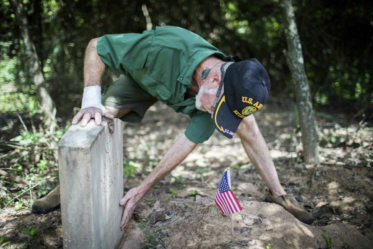 Glenn Brymer takes time to help keep the Spring Peaceful Rest Cemetery clean. Many black veterans of conflicts as long ago as World War I are laid to rest there.