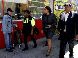 A supporter greets San Francisco Mayor London Breed, third from left, as she participates in a walking tour of the Tenderloin with Jonea Drummer, second from left, community ambassador for Mid Market/Tenderloin, Mohammed Nuru, right, Director of Public Works and other department heads on Friday, July 13, 2018, in San Francisco, Cali.