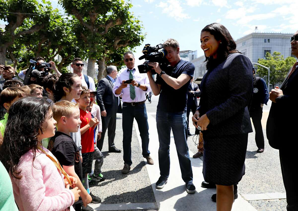 San Francisco Mayor London Breed greets children during a walking tour on July 13, 2018, in San Francisco.