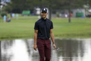 Golden State Warriors NBA basketball player Stephen Curry walks up the second fairway during the first round of the American Century Championship golf tournament at the Edgewood Tahoe Golf Course in Stateline, Nev., Friday,  July 13, 2018. (AP Photo/Lance Iversen)