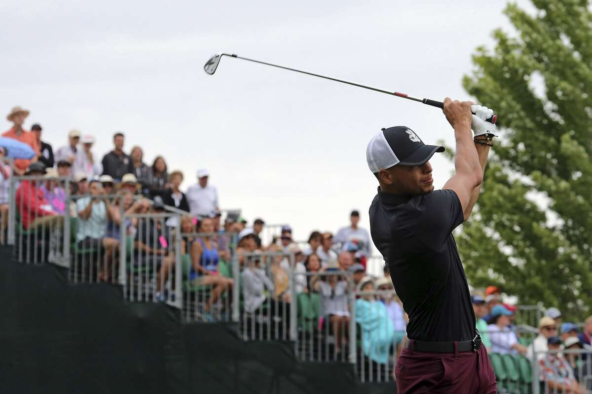 Golden State Warriors NBA basketball player Stephen Curry drives the first hole during the first round of the American Century Championship golf tournament at the Edgewood Tahoe Golf Course in Stateline, Nev., Friday, July 13, 2018. (AP Photo/Lance Iversen)