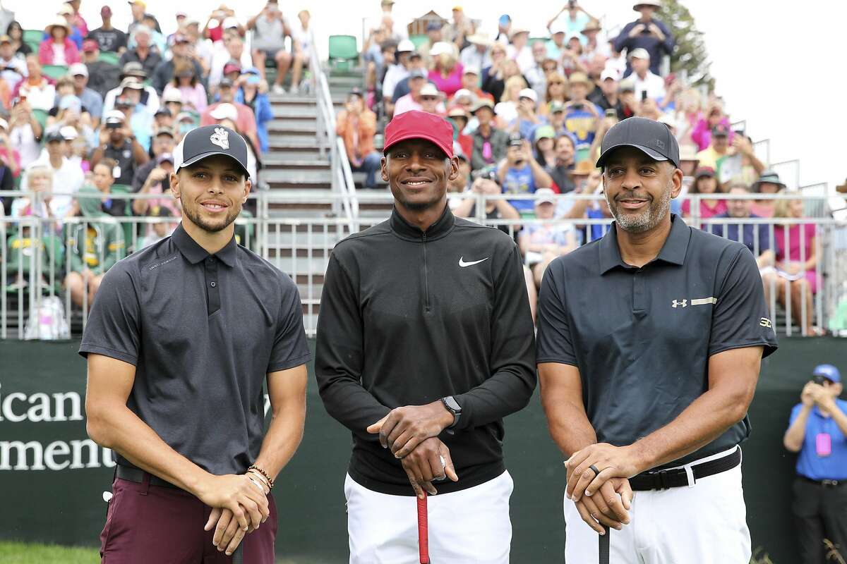 Golden State Warriors NBA basketball player Stephen Curry, left, and former basketball players Ray Allen, center, and Dell Curry pose for a photo prior to teeing off on the first hole during the first round of the American Century Championship golf tournament at the Edgewood Tahoe Golf Course in Stateline, Nev., Friday, July 13, 2018. (AP Photo/Lance Iversen)