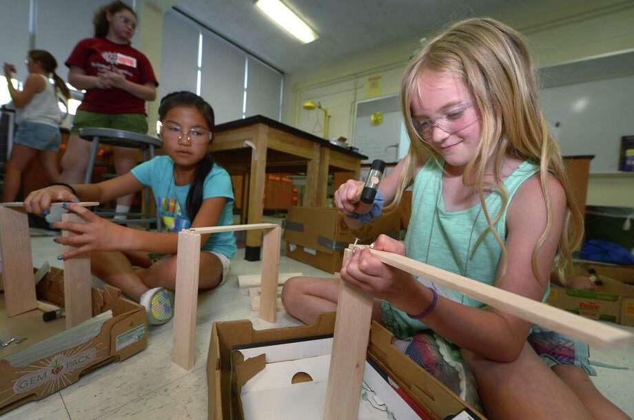 ia DeJaeger and Jenna Zerrusen, both 9, work on a doghouse for their Robotic Pet Vet project during Camp Invention for girls in grades 1-5 Thursday, July 12, 2018, at Nathan Hale Middle School in Norwalk, Conn. The weeklong Camp Invention is a girls STEM summer camp focusing on innovation, creativity and problem solving. Photo: Erik Trautmann / Hearst Connecticut Media / Norwalk Hour