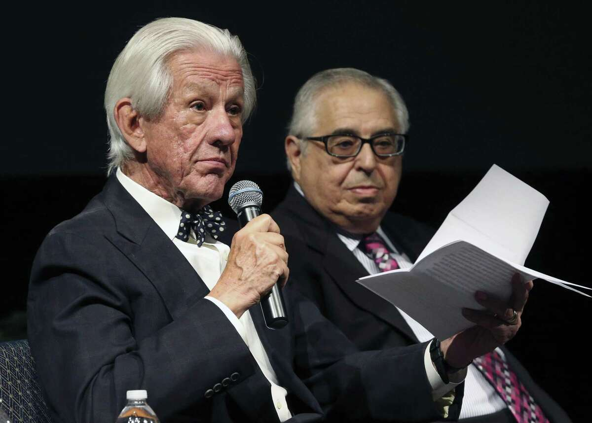 Lionel Sosa reads during an event in 2016. He is newly appointed as one of three chairmen of the Alamo Citizen Advisory Committee. In the background is Gene Rodriguez.