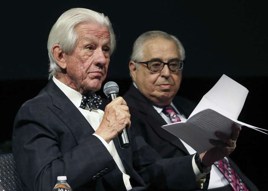 Lionel Sosa reads during an event in 2016. He is newly appointed as one of three chairmen of the Alamo Citizen Advisory Committee. In the background is Gene Rodriguez. Photo: Tom Reel /Staff Photographer / 2016 SAN ANTONIO EXPRESS-NEWS