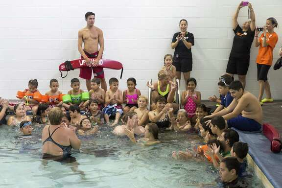 Teaching children in particular how to swim — shown here in 2015 at YMCA San Antonio — is one good preventive strategy to deal with child drownings.