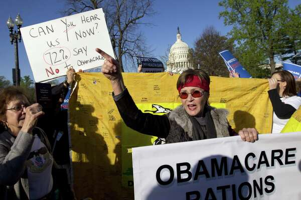 Linda Door of Laguna Beach, Ca., protests outside the United States Supreme Court March 26, 2012, as the court began hearing arguments on the constitutionality of the Affordable Care Act. Unable to repeal the ACA, The Trump administration is now intent on sabatoging it.