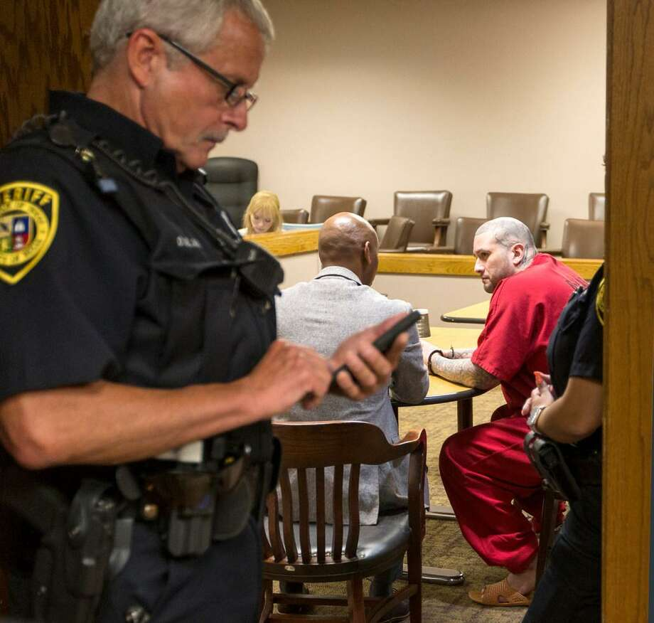 Capital murder suspect Brian Flores, right, talks in the courtroom July 5 with his second chair attorney David Woodward, after a mistrial was declared in Flores' case. Visiting Judge Susan Reed caused this when she made the second chair attorney proceed with jury selection though the first chair was unable to work because of a concussion. Photo: /