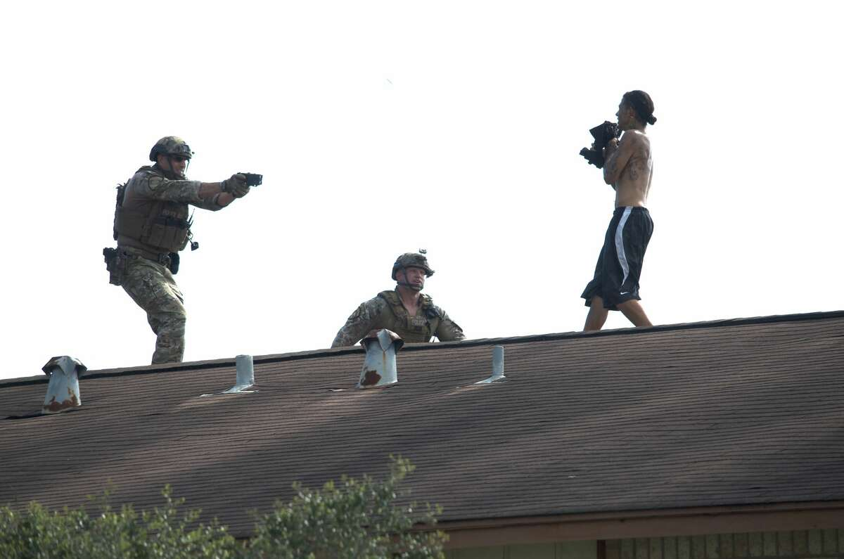 Houston Police Department SWAT officers use a Taser on Patrick Torres, 34, after he allegedly held two women hostage and refused to come down from an apartment complex roof Friday, July 13, 2018.
