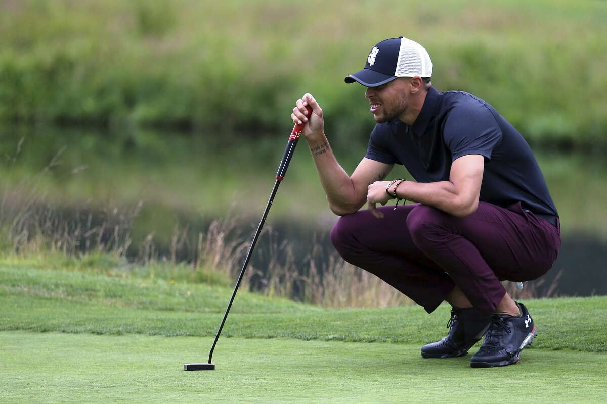 Golden State Warriors All-Star guard Stephen Curry lines up a putt on the first green during the first round at the American Century Golf Championship, Friday, July 13, 2018, at the Edgewood Tahoe Golf Course in Stateline, Nev. (AP Photo/Lance Iversen)