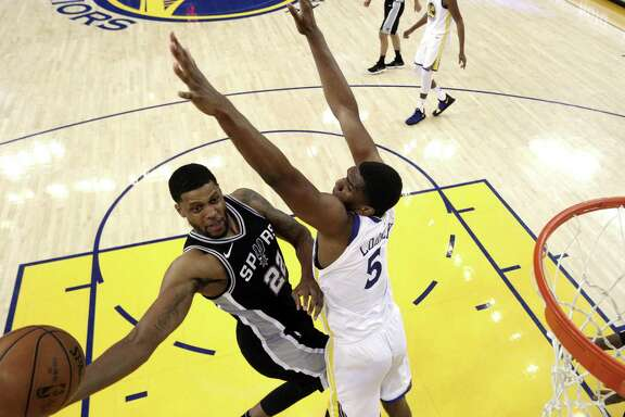 Kevon Looney (5) defends against a shot by Rudy Gay (22) in the second half as the Golden State Warriors played the San Antonio Spurs in Game 5 of the first round of the Western Conference Finals at Oracle Arena in Oakland, Calif., on Tuesday, April 24, 2018. The Warriors won 99-91 to win the series and advance to the second round.
