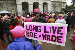 FILE - In this Jan. 22, 2018 file photo, supporters attend a rally held by Planned Parenthood, commemorating the 45th anniversary of the landmark Roe vs. Wade Supreme Court ruling at the Capitol in Sacramento, Calif. The landmark 1973 decision affirmed a woman's right to have an abortion. On Tuesday, Feb. 13, 2018, Planned Parenthood announced an initiative of its own aimed at promoting reproductive health care initiatives in all 50 states over the coming months. (AP Photo/Rich Pedroncelli)