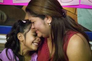 Allison Ximena Valencia Madrid, 6, and her mother Cindy Madrid share a moment during a press conference, Friday, July 13, 2018, in Houston. The press conference, the mother and daughter spoke about the month and one day they were separated during the President Donald Trump administration zero tolerance policy on unlawful border crossing. ( Marie D. De Jesús / Houston Chronicle )