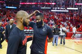 Houston Rockets guard Chris Paul (3) and guard James Harden (13) stand on the court following the second half of Game 2 of the Western Conference Finals at the Toyota Center, Wednesday, May 16, 2018, in Houston. ( Michael Ciaglo  / Houston Chronicle )