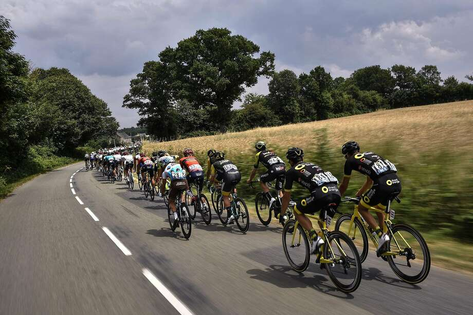 The peloton grinds through the countryside during the seventh — and longest — stage of the Tour de France. Photo: Marco Bertorello / AFP / Getty Images