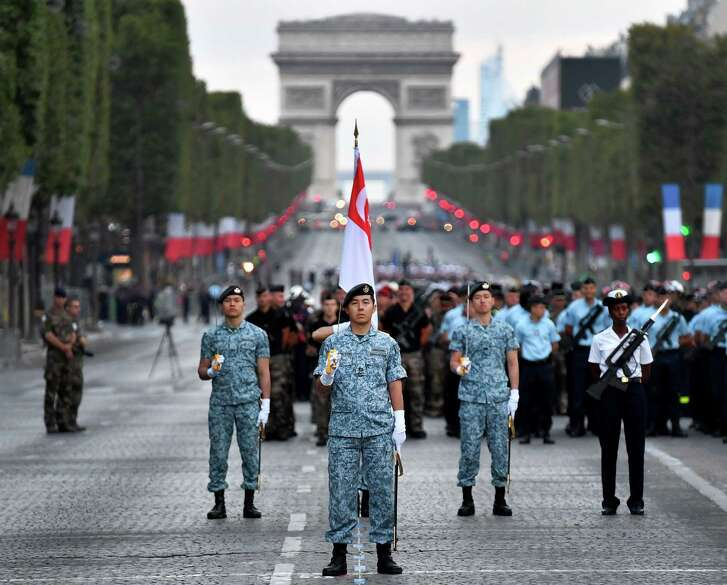 Singapore army soldiers, the foreign nation invited this year with Japan Self-Defense Forces, get prepare on the Champs Elysees, with the Arc de Triomphe in the background, in Paris during a rehearsal of the annual Bastille Day military parade on July 11, 2018.  / AFP PHOTO / GERARD JULIENGERARD JULIEN/AFP/Getty Images