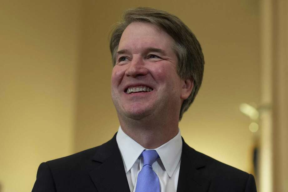 Judge Brett Kavanaugh (L) smiles prior to a meeting with Sen. Benjamin Sasse (R-NE) in the Russell Senate Office Building on July 12, 2018 in Washington, DC. Kavanaugh is meeting with members of the Senate after U.S. President Donald Trump nominated him to succeed retiring Supreme Court Associate Justice Anthony Kennedy. Photo: Alex Edelman / Getty Images / 2018 Getty Images