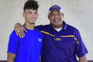 Mike Garrett Jr., left, poses for a photo beside his father Mike Garrett Sr. at Magnolia High School on Friday, July 13, 2018, in Magnolia. Garrett Jr., a 2017 graduate, plays defensive back at Blinn Junior College as he pursues his dream of playing Division I football like his father. Garrett Sr. played wide receiver for LSU in the early 1990s beside New York Giants wide receiver Odell Beckham Sr. and Conroe native Tyke Tolbert.