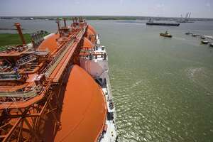 An oil tanker, right, cruises past a new liquefied natural gas tanker at the Cheniere terminal in Cameron Parish, La., May 20, 2008. By 2017, the facility built by Houston-based Cheniere Energy could handle an amount equal to roughly a sixth of the gas that flows from Russia to Europe, part of a new surge of LNG supplies coming not only from the U.S., but also Australia, Africa and the Middle East. (Michael Stravato/The New York Times)