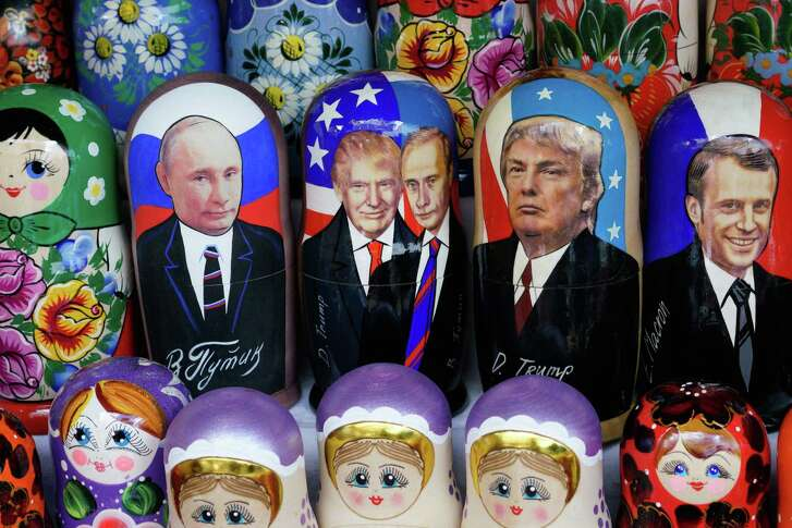 Russian Matryoshka dolls depicting Russian President Vladimir Putin and US President Donald Trump are seen on sale at Izmailovo flea market in Moscow on July 13, 2018, three days before the meeting of Russian President Vladimir Putin and US President Donald Trump to be held in Helsinki. / AFP PHOTO / Maxim ZmeyevMAXIM ZMEYEV/AFP/Getty Images