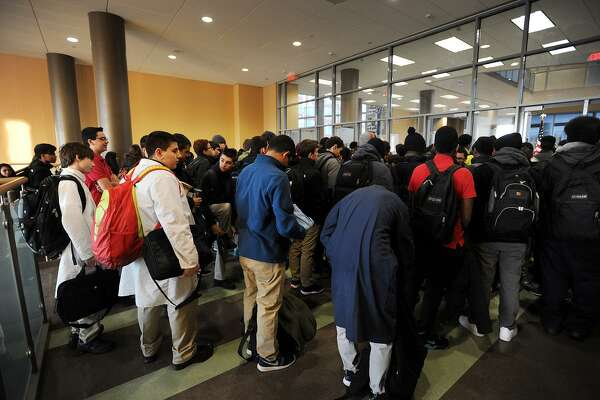 Hundreds of students wait to have their backpacks searched and pass through metal detectors at the start of the school day at the Fairchild Wheeler Interdistrict Magnet School in Bridgeport, Conn. on Thursday, January 29, 2015.