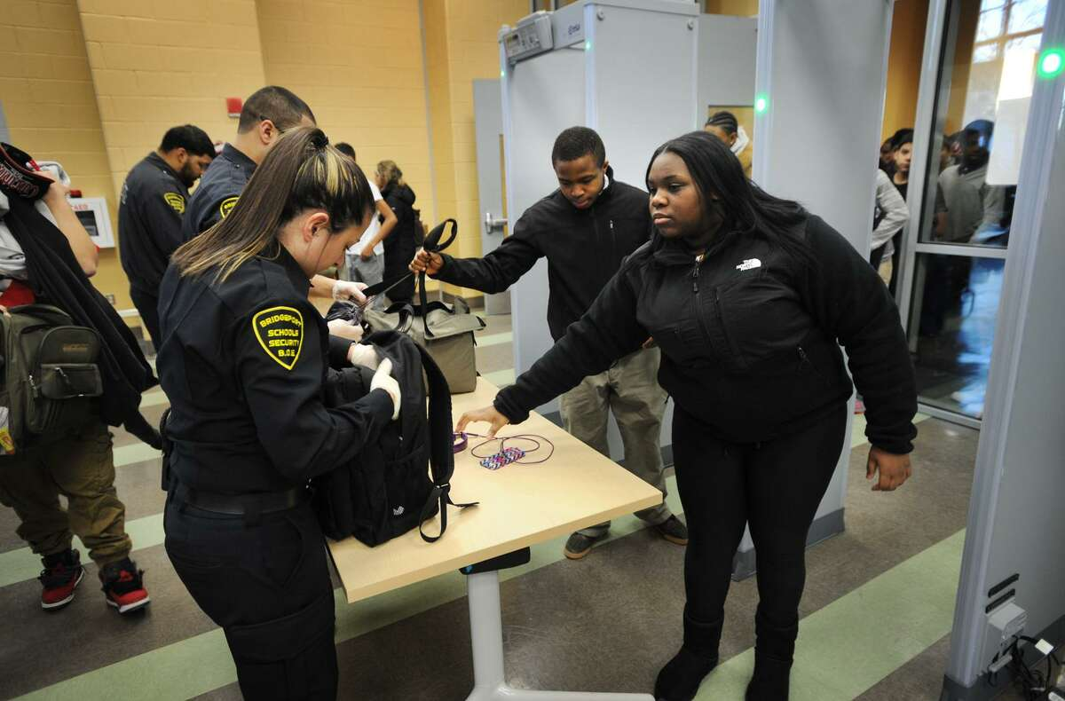 Students have their backpacks searched and pass through metal detectors at the start of the school day at the Fairchild Wheeler Interdistrict Magnet School in Bridgeport, Conn. on Thursday, January 29, 2015.